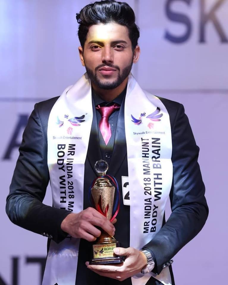 ankur gautam with trophy